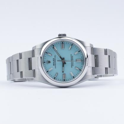 Đánh giá siêu phẩm đồng hồ Rolex Oyster Perpetual 41 124300 xanh ngọc lam vô cùng lạ mắt