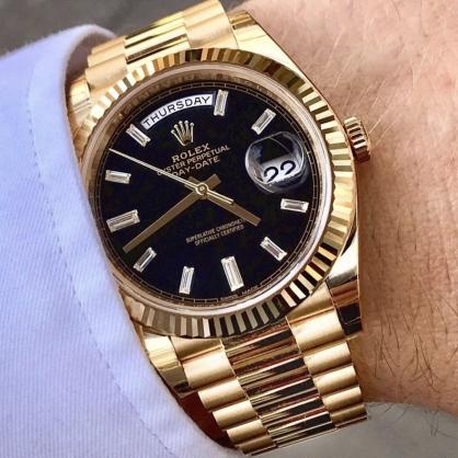 Đồng hồ Rolex Day-Date 40 228238 mặt số đen nạm kim cương Baguette
